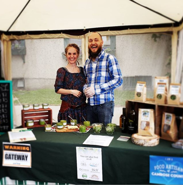 Elin & Brock of Grub & Shrub Farm at the downtown Camrose farmers market